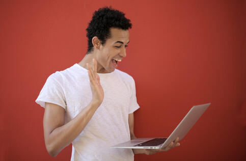 Canva - Cheerful man using laptop for video call